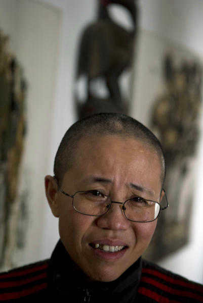 Liu Xia, wife of 2010 Nobel Peace Prize winner Liu Xiaobo, speaks to journalists from The Associated Press during her first interview in more than two years at her home in Beijing, China, on Thursday, Dec, 6, 2012. Liu trembled uncontrollably and cried Thursday as she described how her confinement under house arrest has been absurd and emotionally draining in the two years since her jailed activist husband was named a Nobel Peace laureate. (AP Photo/Ng Han Guan)
