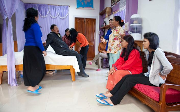 Mr Chana with some of his wives in his bedroom in 2011 - Barcroft Media