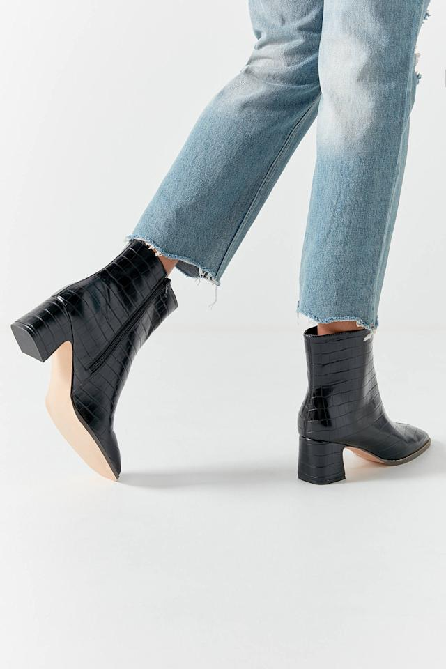 """<p>These <a href=""""https://www.popsugar.com/buy/UO-Kate-Croc-Ankle-Boots-482907?p_name=UO%20Kate%20Croc%20Ankle%20Boots&retailer=urbanoutfitters.com&pid=482907&price=79&evar1=fab%3Aus&evar9=45235540&evar98=https%3A%2F%2Fwww.popsugar.com%2Ffashion%2Fphoto-gallery%2F45235540%2Fimage%2F46525733%2FUO-Kate-Croc-Ankle-Boots&list1=shopping%2Cfall%20fashion%2Cshoes%2Cboots%2Cfall&prop13=mobile&pdata=1"""" rel=""""nofollow"""" data-shoppable-link=""""1"""" target=""""_blank"""" class=""""ga-track"""" data-ga-category=""""Related"""" data-ga-label=""""https://www.urbanoutfitters.com/shop/uo-kate-croc-ankle-boot?category=boots-for-women&amp;color=001&amp;quantity=1&amp;type=REGULAR"""" data-ga-action=""""In-Line Links"""">UO Kate Croc Ankle Boots</a> ($79) are quite comfortable.</p>"""