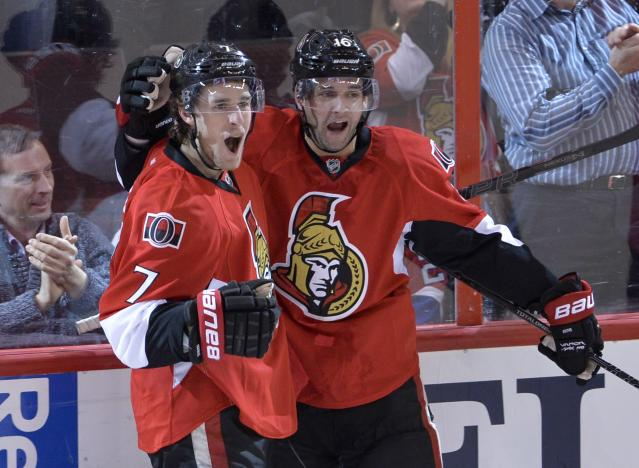 Ottawa Senators center Kyle Turris, left, celebrates his second-period goal with Clarke MacArthur against the Montreal Canadiens during an NHL hockey game Thursday, Jan. 16, 2014, in Ottawa, Ontario. (AP Photo/The Canadian Press, Adrian Wyld)