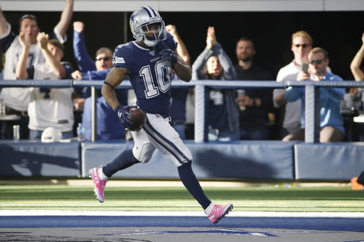 Dallas Cowboys wide receiver Tavon Austin (10) scores a touchdown in the first half of an NFL football game against the Los Angeles Rams in Arlington, Texas, Sunday, Dec. 15, 2019. (AP Photo/Ron Jenkins)