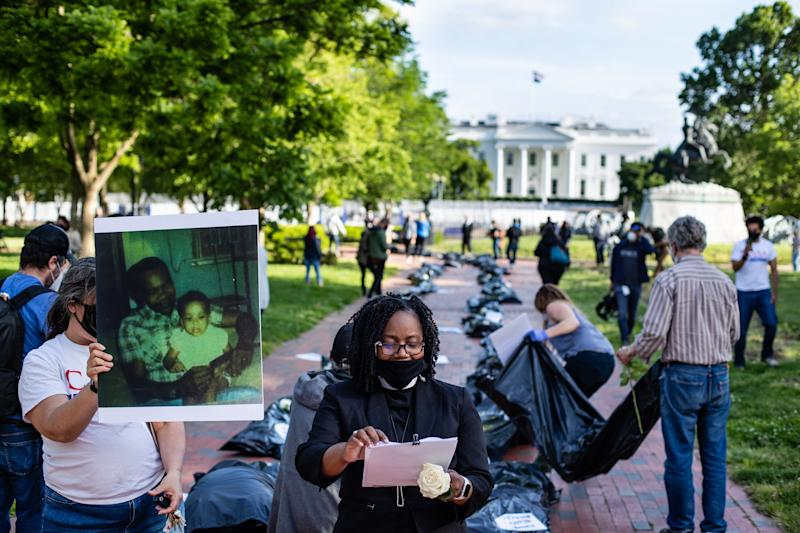 Progressive activists outside the White House in Washington, D.C., lay body bags and photos of loved ones killed by the coronavirus on May 20 as part of nationwide demonstrations against President Donald Trump's handling of the pandemic, which has killed nearly 100,00 people in the U.S. (Yilmaz Akin/Subminimal for Care in Action)