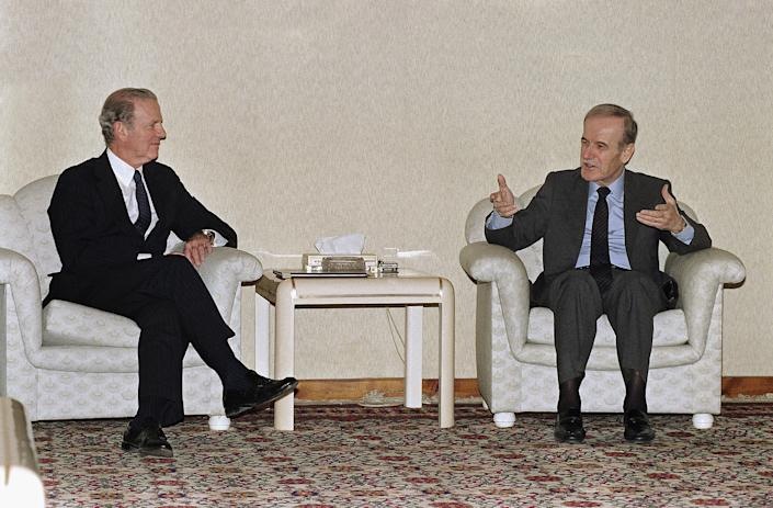 Baker, left, talks with Syrian President Hafez al-Assad before their meeting in Damascus in March 1991.