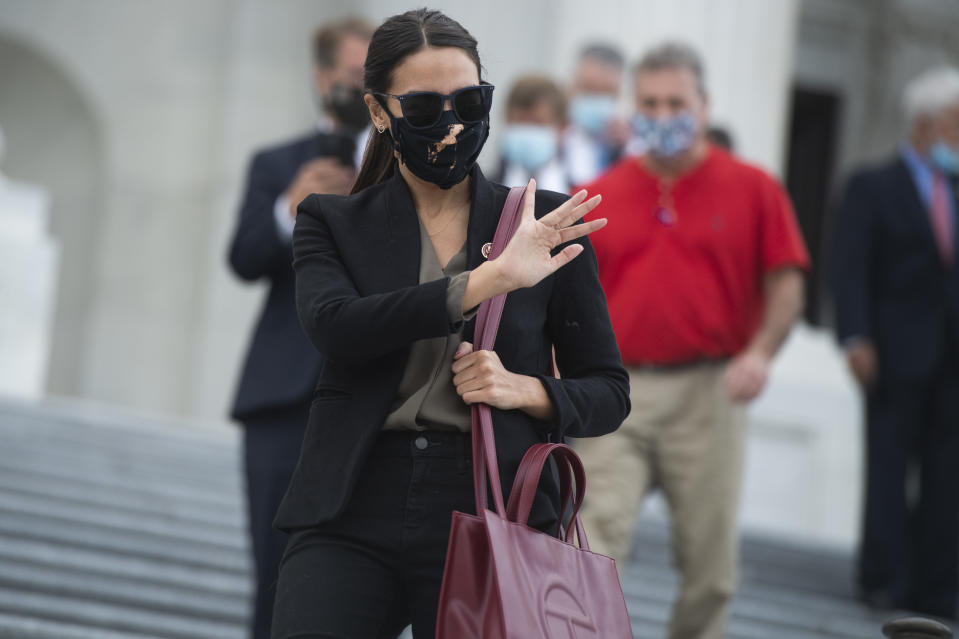 UNITED STATES - AUGUST 22: Rep. Alexandria Ocasio-Cortez, D-N.Y., leaves the Capitol as the House voted on a bill to ban changes to U.S. Postal Service operations and provide $25 billion in funding on Saturday August 22, 2020. Rep. Roger Williams, R-Texas, appears at left. (Photo By Tom Williams/CQ-Roll Call, Inc via Getty Images)