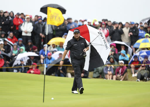 Ireland's Shane Lowry walks with his umbrella on the 6th green during the final round of the British Open Golf Championships at Royal Portrush in Northern Ireland, Sunday, July 21, 2019.(AP Photo/Peter Morrison)
