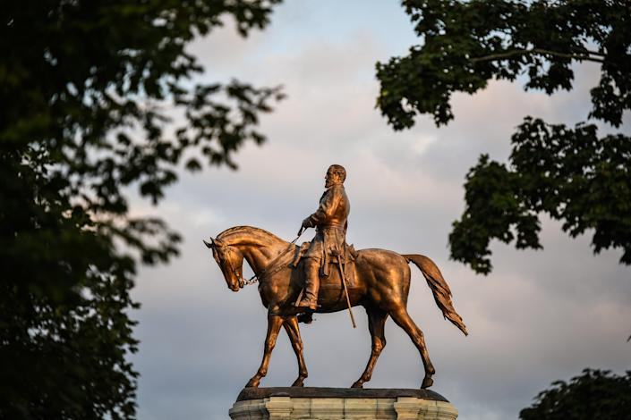 A statue of Confederate general Robert E. Lee is photographed at the center of Lee Circle along Monument Avenue in Richmond, Virginia.
