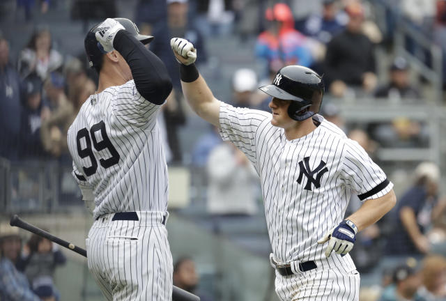 New York Yankees' DJ LeMahieu, right is greeted near the dugout by Aaron Judge (99) after hitting a solo home run off Kansas City Royals starting pitcher Heath Fillmyer during the fourth inning of a baseball game, Saturday, April 20, 2019, in New York. (AP Photo/Julio Cortez)