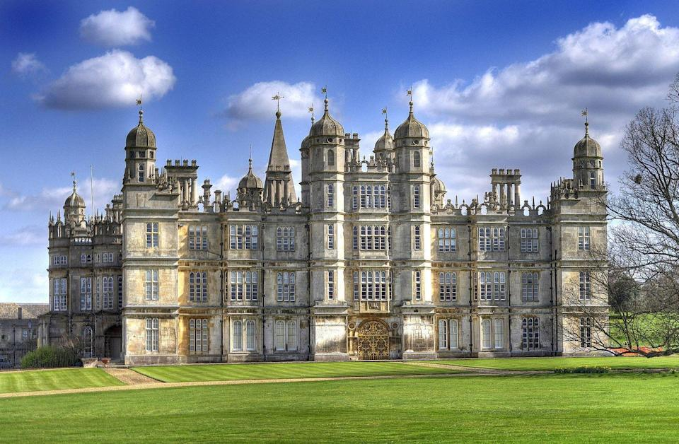 <p>The grandiose Burghley House may look familiar to you if you're a period drama connoisseur—it was also featured in the 2005 film adaptation of <em>Pride and Prejudice</em>. In season four of <em>The Crown</em>, this home acts as Windsor Castle. The stately home actually has royal ties in real life: Burghley House was built nearly 500 years ago by Sir William Cecil, Queen Elizabeth I's Lord High Treasurer. Both the house and the gardens are open to the public, and the home's interiors are unlike anything us commoners are used to. Expect to see cathedral-esque painted ceilings and walls that are so extravagant Michelangelo would be jealous. </p>