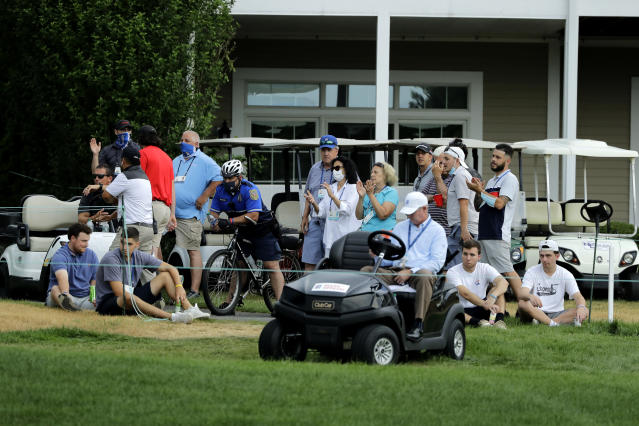 Spectators react after Brendon Todd putted on the 12th green during the final round of the Travelers Championship golf tournament at TPC River Highlands, Sunday, June 28, 2020, in Cromwell, Conn. (AP Photo/Frank Franklin II)