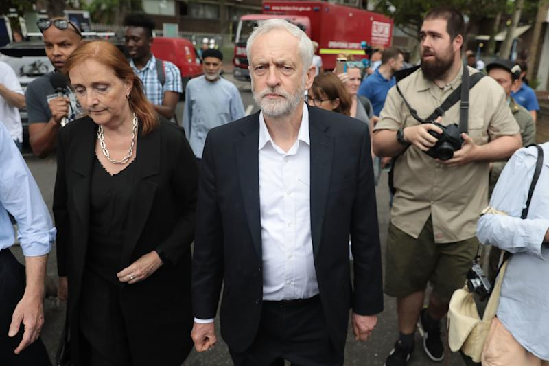 <strong>Labour leader Jeremy Corbyn visits the scene of the Grenfell Tower fire with MP for Kensington, Emma Dent Coad </strong> (Jack Taylor via Getty Images)