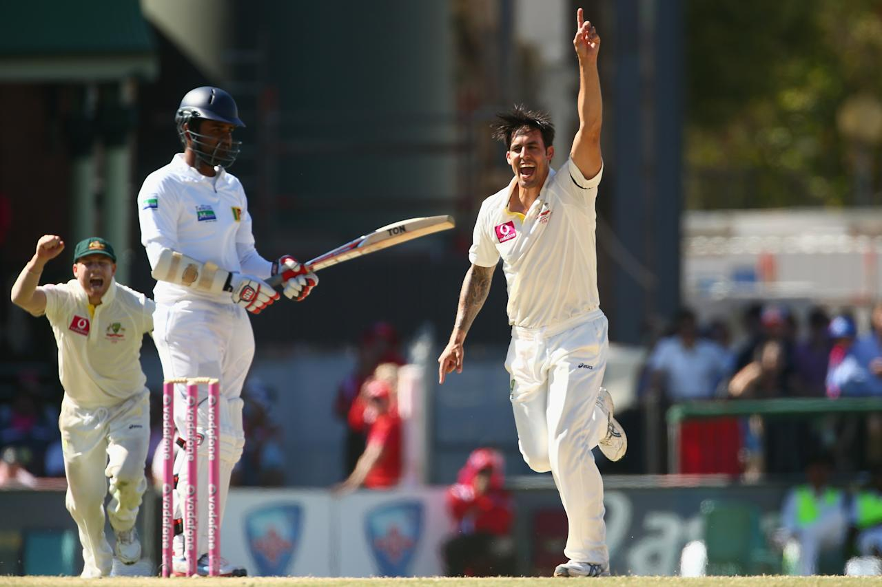 SYDNEY, AUSTRALIA - JANUARY 05:  Mitchell Johnson of Australia celebrates taking the wicket of Lahiru Thirimanne of Sri Lanka during day three of the Third Test match between Australia and Sri Lanka at Sydney Cricket Ground on January 5, 2013 in Sydney, Australia.  (Photo by Mark Kolbe/Getty Images)