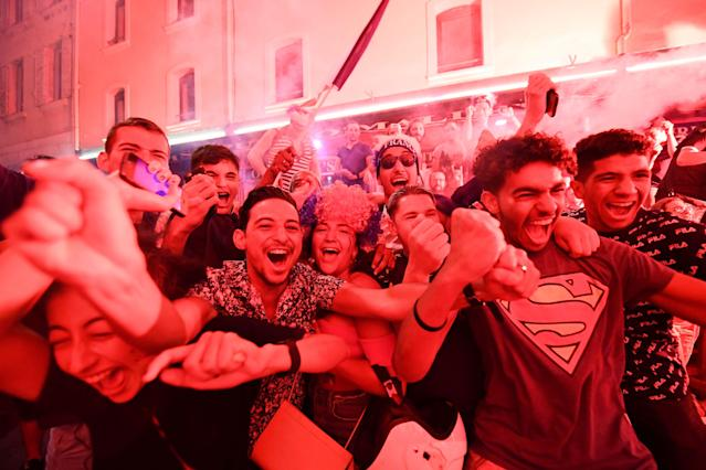 <p>People celebrate France's victory in Marseille on July 10, 2018 after the final whistle of the Russia 2018 World Cup semi-final football match between France and Belgium. (Photo by Boris HORVAT / AFP) </p>