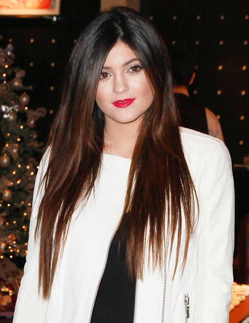 Attending a Kardashian Khaos store meet and greet in 2012, Jenner pairs her long, ombre locks with a bright, red lip.