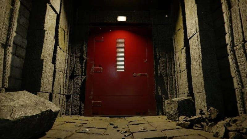 A large red door at the end of a stone hallway from Call of Duty's new fast-travel system.