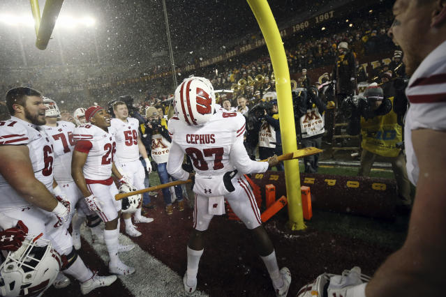 Wisconsin wide receiver Quintez Cephus (87) holds Paul Bunyan's Axe in celebration after Wisconsin beat Minnesota 38-17 in an NCAA college football game Saturday, Nov. 30, 2019, in Minneapolis. (AP Photo/Stacy Bengs)