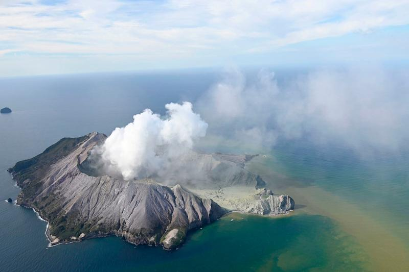 A huge cloud of ash billows into the sky above White Island following the eruption on Monday: AP