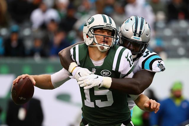 <p>Josh McCown #15 of the New York Jets is sacked by defensive end Mario Addison #97 of the Carolina Panthers during the third quarter of the game at MetLife Stadium on November 26, 2017 in East Rutherford, New Jersey. (Photo by Al Bello/Getty Images) </p>