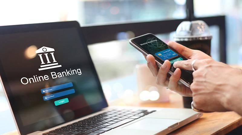 Man using online banking with credit card on touch screen device. Mobile banking. Digital and internet payments shopping on network connection. Bank login on a laptop screen. All on screen and credit card are design up.