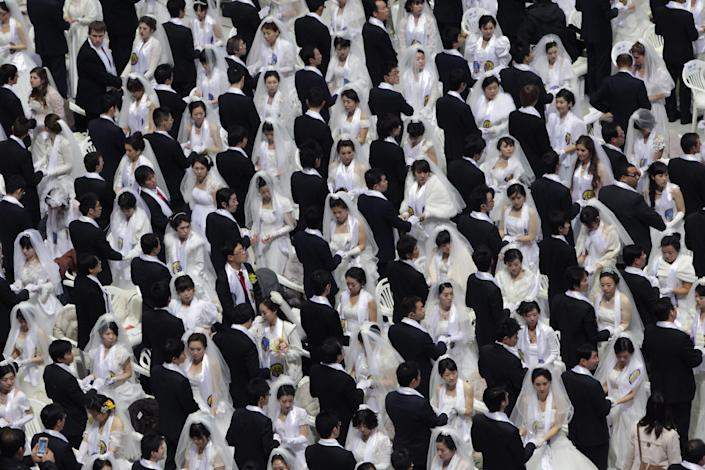 Thousands of couples take part in a mass wedding ceremony at Cheongshim Peace World Center on February 17, 2013 in Gapyeong-gun, South Korea.