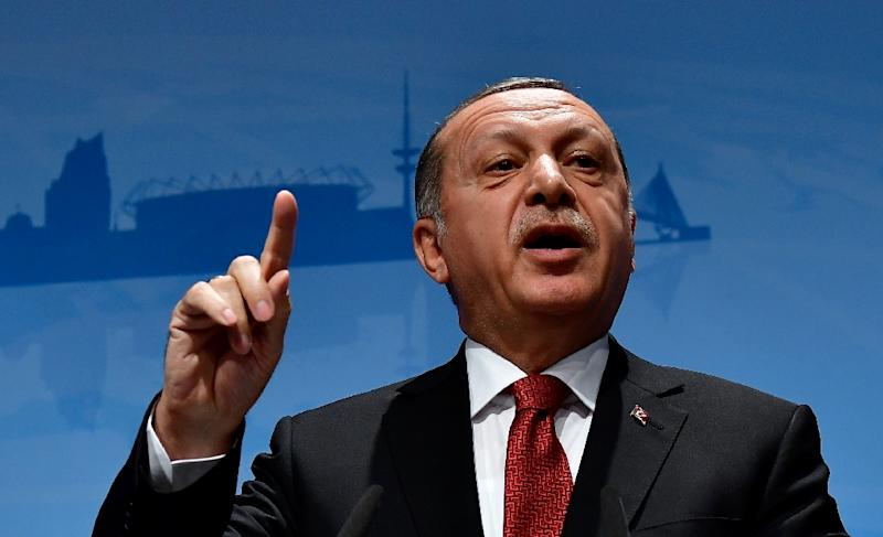 Turkey's President Recep Tayyip Erdogan says rights activists have continued the work of those who sought to oust him in a coup last year