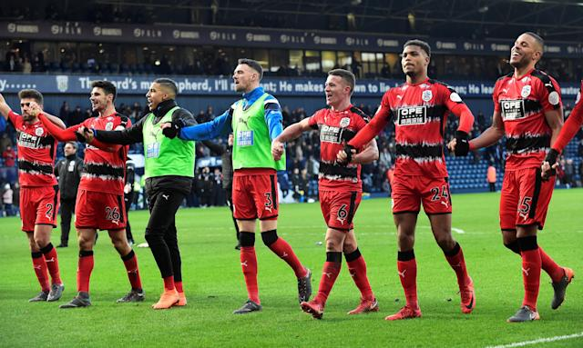"""Soccer Football - Premier League - West Bromwich Albion vs Huddersfield Town - The Hawthorns, West Bromwich, Britain - February 24, 2018 Huddersfield Town players celebrate after the match REUTERS/Rebecca Naden EDITORIAL USE ONLY. No use with unauthorized audio, video, data, fixture lists, club/league logos or """"live"""" services. Online in-match use limited to 75 images, no video emulation. No use in betting, games or single club/league/player publications. Please contact your account representative for further details."""