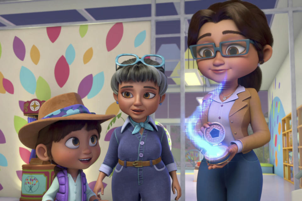 """This image released by Netflix shows characters, from left, Ridley, voiced by Iara Nemirovsky, Grandma Jones, voiced by Blythe Danner, and Mama Jones, voiced by Sutton Foster in a scene from the animated series """"Ridley Jones."""" (Netflix via AP)"""