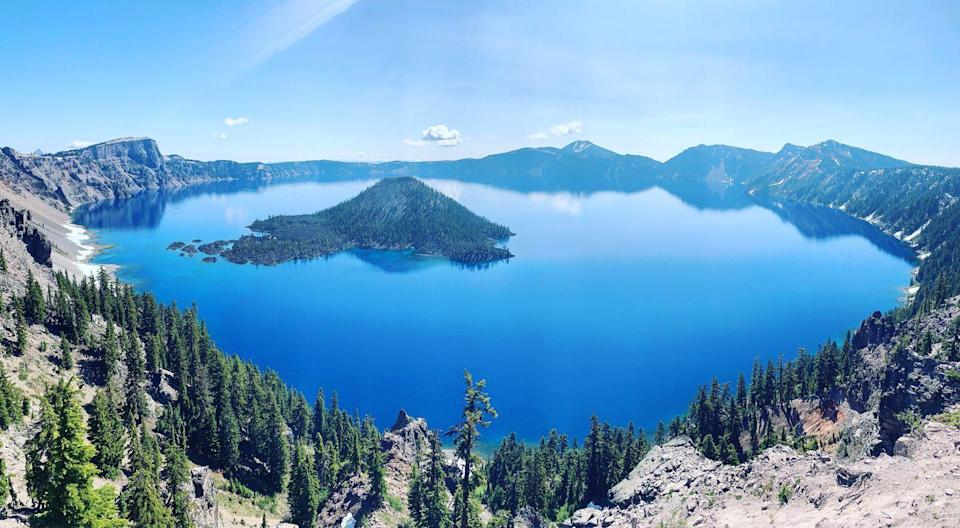 <p><strong>Crater Lake</strong> is literally a lake in a volcanic crater that filled with water over time. It is the focal point of Crater Lake National Park, atop the Cascade Mountain Range in Oregon. </p>