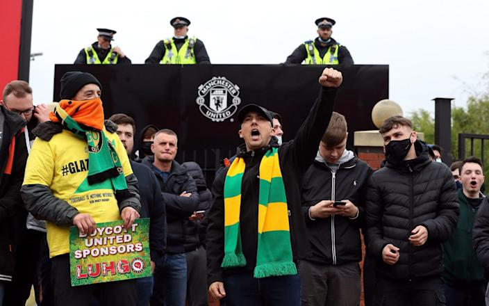Manchester United fans outside the ground with police presence during a protest against the Glazer family - PA