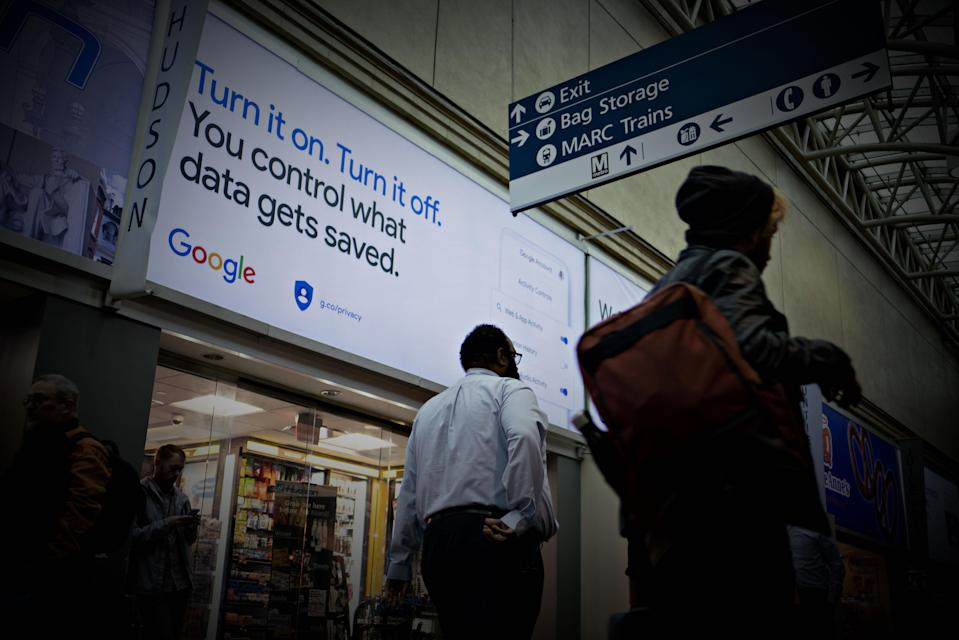 People walk past Google privacy and security settings signage displayed inside Union Station in Washington, D.C., U.S., on Tuesday, Oct. 22, 2019. Spending by Alphabet Inc.'s Google on lobbying dropped almost 50% to $2.8 million from $5.5 million during the same period last year as it reshuffles its Washington lobbying operations under Karan Bhatia, the global policy chief who joined the company last year. Photographer: Andrew Harrer/Bloomberg