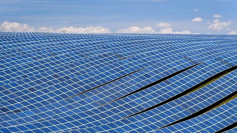 A view shows photovoltaic solar panels at the power plant in La Colle des Mées, Alpes de Haute Provence, south eastern France, on April 17, 2019.