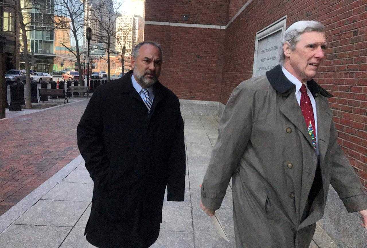 FILE PHOTO:    Kenneth Brissette (L), director of tourism, sports and entertainment for the city of Boston and defense attorney William Kettlewell, enter federal court in Boston, Massachusetts, U.S., December 4, 2017.  Photo taken December 4, 2017.  REUTERS/Nate Raymond/File Photo