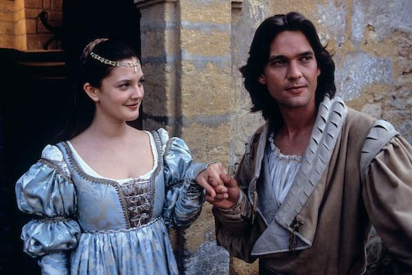 Drew Barrymore looking charmed as Dougray Scott holds her hand.