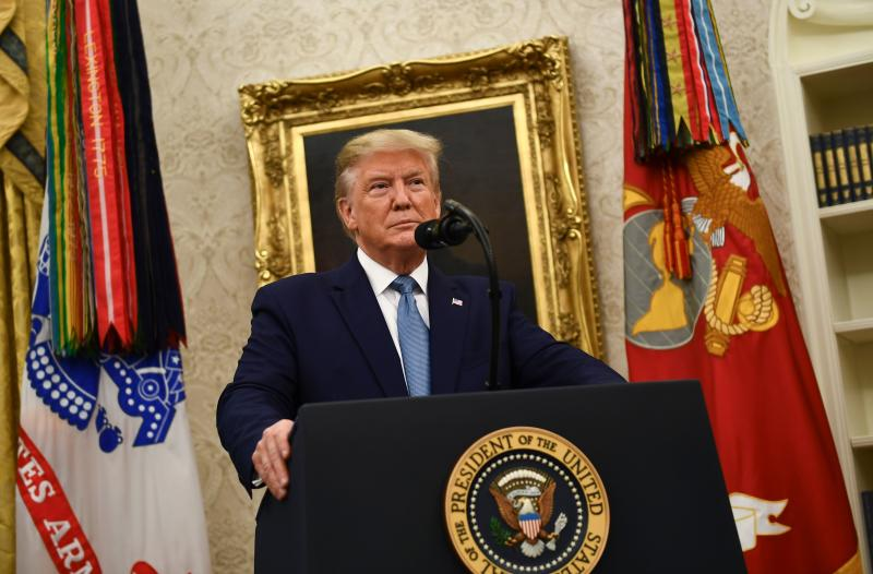 US President Donald Trump speaks before awarding the Medal of Freedom to former Attorney General Edwin Meese during a ceremony in the Oval Office at the White House in Washington, DC on October 8, 2019. (Photo by Brendan Smialowski / AFP) (Photo by BRENDAN SMIALOWSKI/AFP via Getty Images)