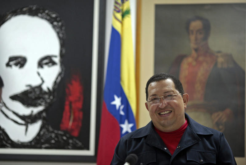 In this photo released by Miraflores Press Office Sunday March 4, 2012, Venezuela's President Hugo Chavez smiles during a televised speech, backdropped by framed images of Cuban national hero and poet Jose Marti, left, and Venezuela's independence hero Simon Bolivar, right, at an undisclosed location in Havana, Cuba, Saturday March 3, 2012. Chavez appeared Sunday on television for the first time in nine days during which he underwent surgery in Cuba to remove a tumor. Chavez spoke firmly in footage recorded Saturday in Havana. (AP Photo/Miraflores Press Office/Marcelo Garcia)
