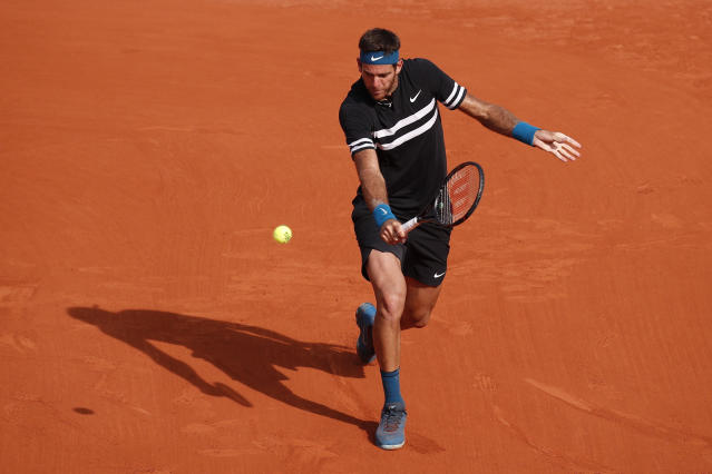 Argentina's Juan Martin del Potro returns a shot against Spain's Rafael Nadal during their semifinal match of the French Open tennis tournament at the Roland Garros stadium in Paris, France, Friday, June 8, 2018. (AP Photo/Christophe Ena)