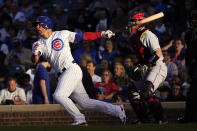 Chicago Cubs' Willson Contreras, leeft, watches his double off Cleveland Indians' Aaron Civale as the sun sets over Wrigley Field during the second inning of a baseball game Monday, June 21, 2021, in Chicago. (AP Photo/Charles Rex Arbogast)