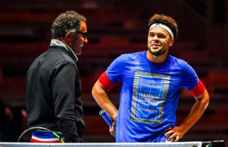 France's tennis player Jo-Wilfried Tsonga (R) speaks with team captain Yannick Noah during a training session in Villeneuve d'Ascq on November 22, 2017, ahead of their Davis Cup World Group final against Belgium