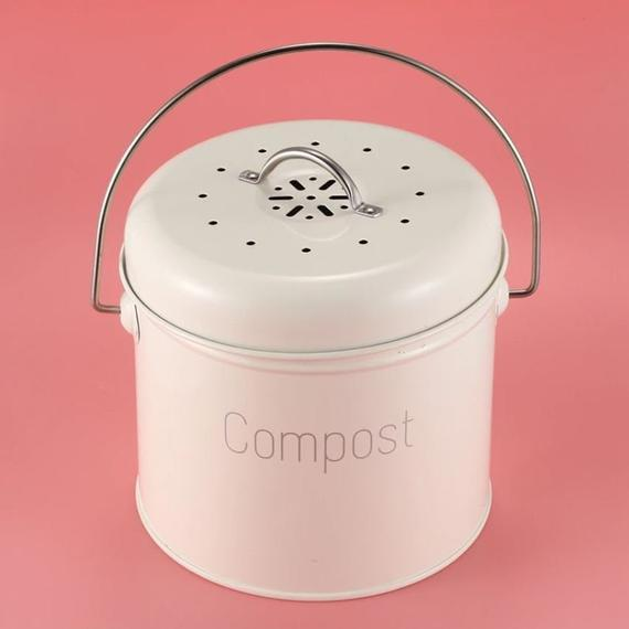 """<h2>Etsy Countertop Compost Bin</h2><br>The idea of food rotting in a can on your counter can be pretty unappealing, but this adorable cream can gets the job done without ruining the vibe of your kitchen. According to one Etsy lover, this can's compact size and activated carbon filters also zap any away smells (no flies!): """"I love my little compost bin! It's beautiful enough to leave out on the counter and the filters/lids keep the kitchen smelling great!"""" <br><br><em>Shop <strong><a href=""""https://www.etsy.com/shop/LoveSustainLifestyle"""" rel=""""nofollow noopener"""" target=""""_blank"""" data-ylk=""""slk:LoveSustainLifestyle"""" class=""""link rapid-noclick-resp"""">LoveSustainLifestyle</a></strong></em><br><br><strong>LoveSustainLifestyle</strong> Countertop Compost Bin + Activated Carbon Filter, $, available at <a href=""""https://go.skimresources.com/?id=30283X879131&url=https%3A%2F%2Fwww.etsy.com%2Flisting%2F833681747%2Fcountertop-compost-bin-activated-carbon"""" rel=""""nofollow noopener"""" target=""""_blank"""" data-ylk=""""slk:Etsy"""" class=""""link rapid-noclick-resp"""">Etsy</a>"""