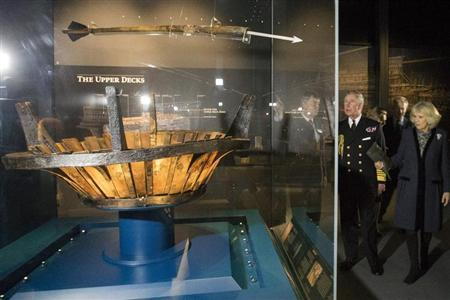 Britain's Prince Charles looks at artefacts during his visit with Camilla, Duchess of Cornwall, to the Mary Rose Museum in Portsmouth,