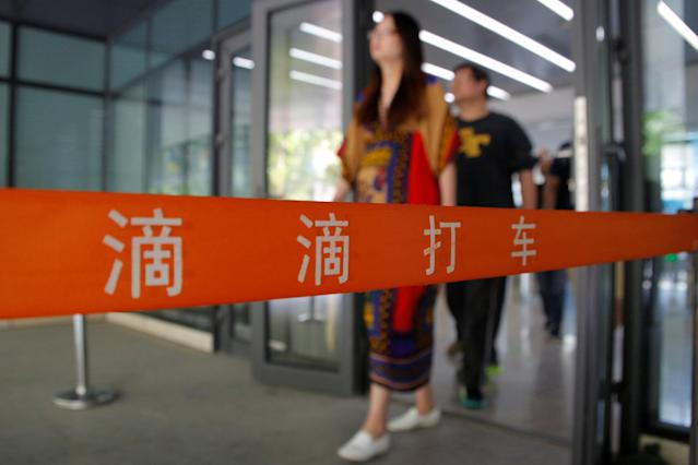 People walk out of the headquarters of Didi Chuxing in Beijing, China, May 18, 2016. REUTERS/Kim Kyung-Hoon