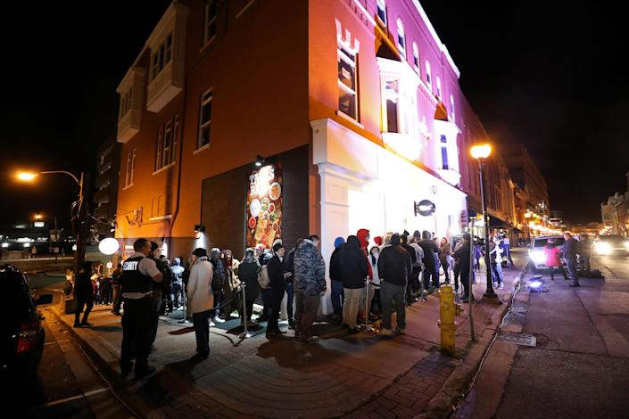 <p>Customers line up to purchase the first legal recreational marijuana that will go on sale after midnight at a Tweed retail store in St John's, Newfoundland and Labrador, Canada, Oct. 16, 2018. (Photo: Chris Wattie/Reuters) </p>
