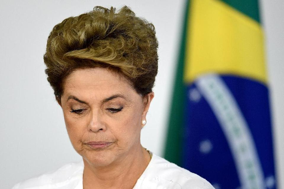 Brazilian President Dilma Rousseff is fighting allegations she tried to mask the depth of economic troubles during her 2014 re-election victory (AFP Photo/Evaristo Sa)