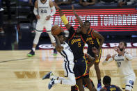 Memphis Grizzlies' Ja Morant, left, drives against Golden State Warriors' Kevon Looney (5) during the second half of an NBA basketball Western Conference play-in game in San Francisco, Friday, May 21, 2021. (AP Photo/Jed Jacobsohn)