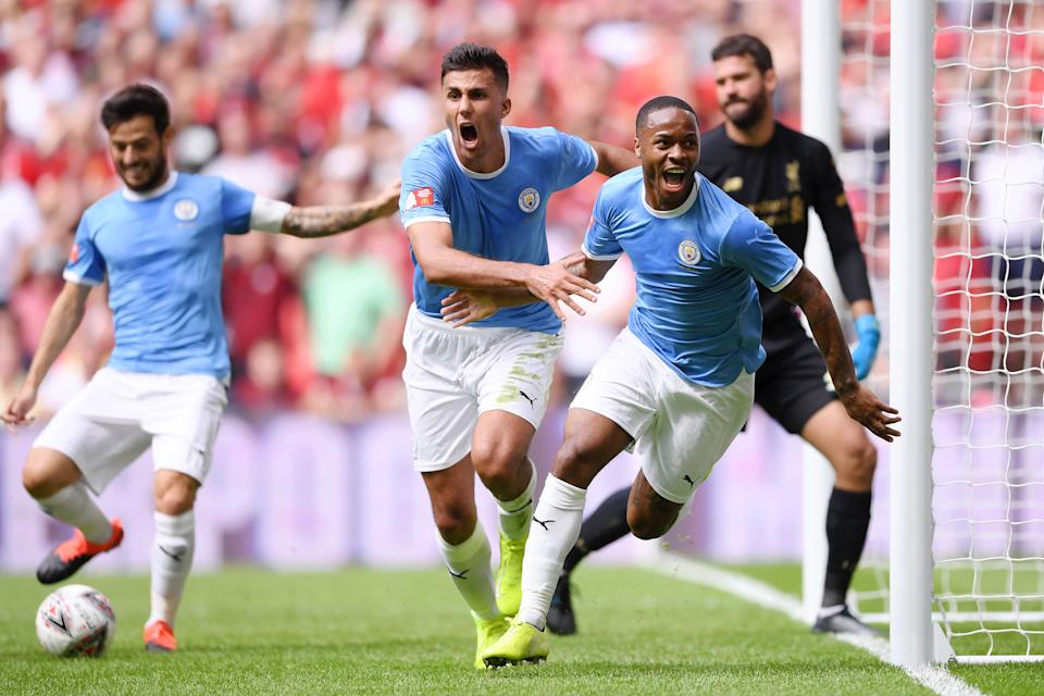 Raheem Sterling celebrates after scoring his team's first goal. (Credit: Getty Images)