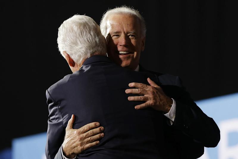Vice President Joe Biden hugs former President Bill Clinton during a campaign rally at the Covelli Centre, Monday, Oct. 29, 2012, in Youngstown, Ohio. (AP Photo/Matt Rourke)