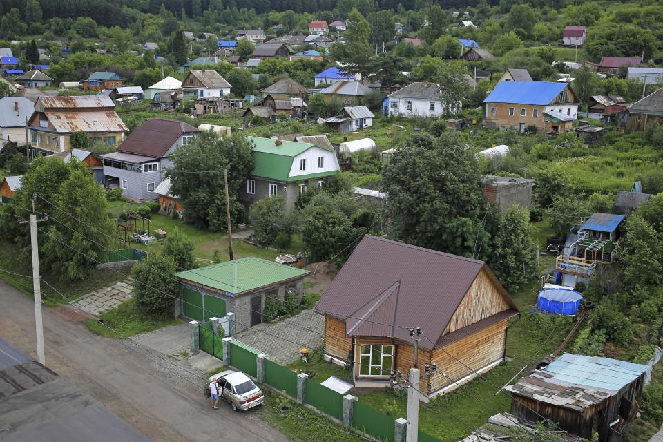 In this photo taken on Thursday, July 5, 2018, a view of a residential houses, in Kaltan, Russia. When Russia plays at the World Cup, Kaltan looks like a ghost town. This remote Siberian coal-mining town is the home of Golovin, whose key role in Russia's run to the World Cup quarterfinals has made him a national hero.(AP Photo/Yaroslav Belyaev)