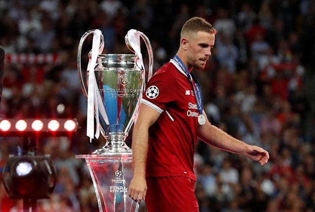 Soccer Football - Champions League Final - Real Madrid v Liverpool - NSC Olympic Stadium, Kiev, Ukraine - May 26, 2018 Liverpool's Jordan Henderson looks dejected as he walks past the Champions League trophy during the medal ceremony after the match REUTERS/Andrew Boyers