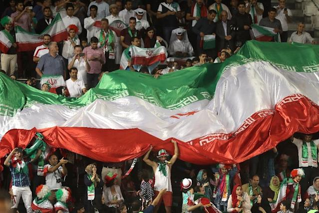 Iranian fans wave their national flag during their World Cup 2018 Asia qualifying football match against Qatar Doha on March 23, 2017 (AFP Photo/KARIM JAAFAR)