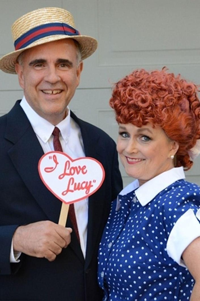 """<p>Embody everyone's favorite '50s couple this Halloween. All you need is a red wig, a polka-dotted dress, a straw hat, and a DIY sign. </p><p><strong>Get the tutorial at <a href=""""http://www.yourhomebasedmom.com/lucy-ricky/"""" rel=""""nofollow noopener"""" target=""""_blank"""" data-ylk=""""slk:Your Homebased Mom"""" class=""""link rapid-noclick-resp"""">Your Homebased Mom</a>.</strong></p><p><strong><a class=""""link rapid-noclick-resp"""" href=""""https://www.amazon.com/Miusol-Womens-Vintage-Casual-X-Large/dp/B00XXPOACS/?tag=syn-yahoo-20&ascsubtag=%5Bartid%7C10050.g.4616%5Bsrc%7Cyahoo-us"""" rel=""""nofollow noopener"""" target=""""_blank"""" data-ylk=""""slk:SHOP POLKA DOT DRESSES"""">SHOP POLKA DOT DRESSES</a></strong></p>"""