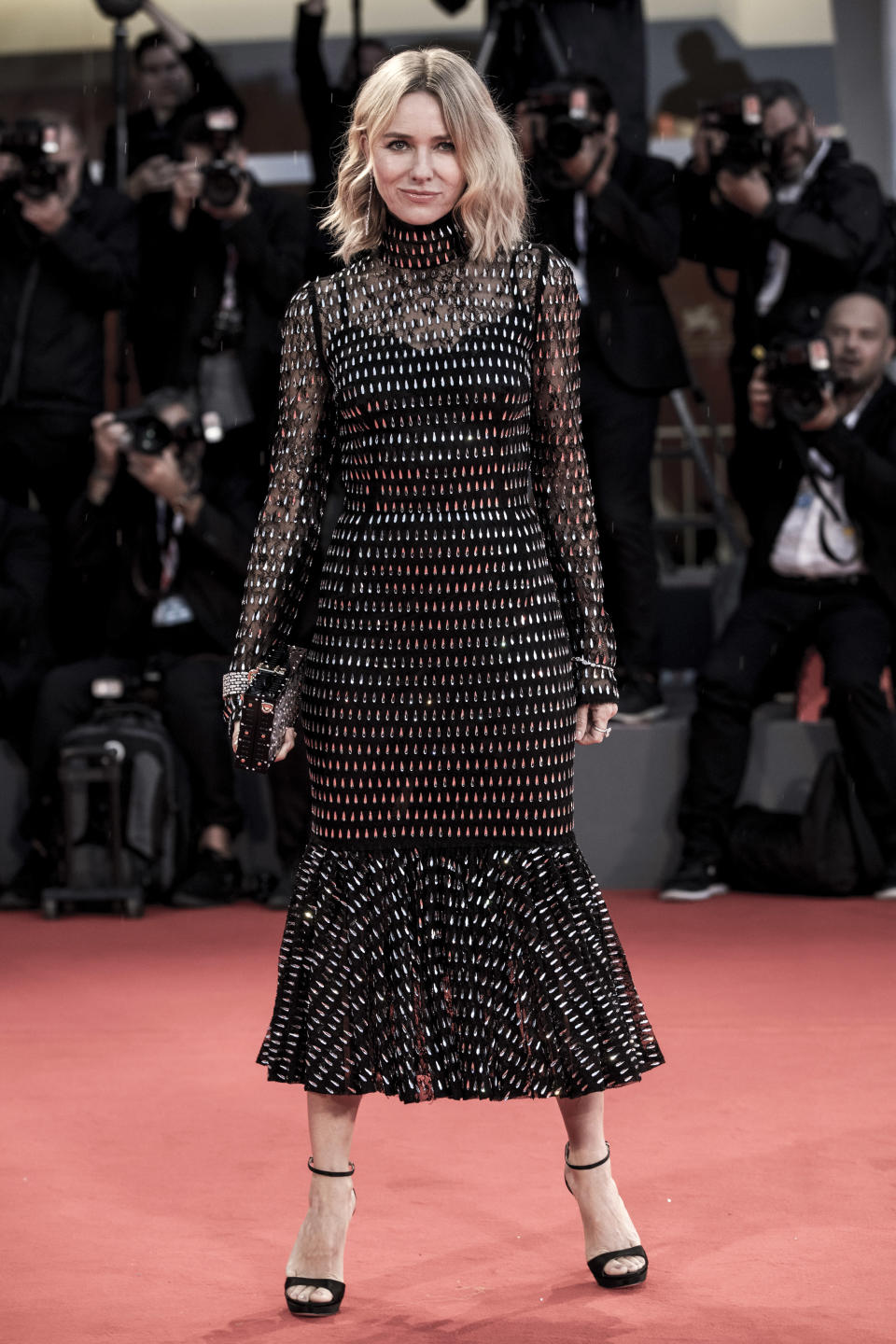 <p>Celebrating her host country, Naomi opted for a fishtail skirt dress by Dolce & Gabbana. <em>[Photo: Getty]</em> </p>